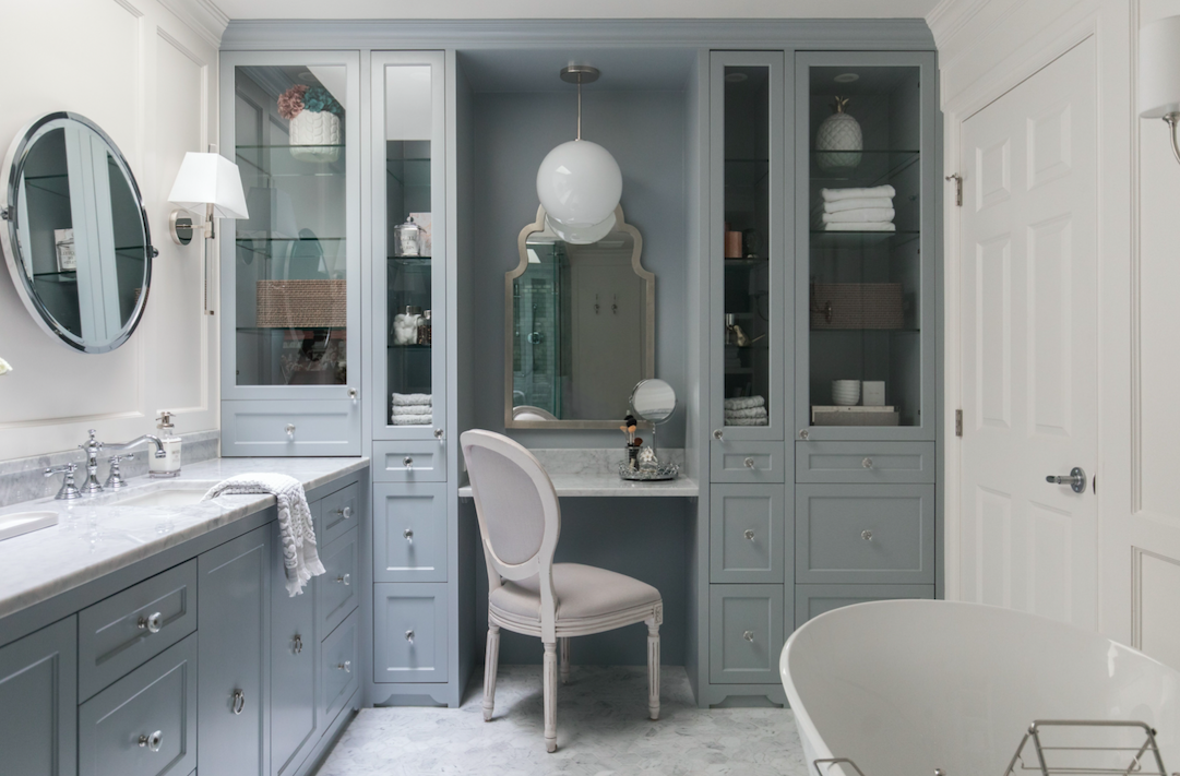 Fresh, traditional master suite design and renovation with double vanity and built-in makeup station