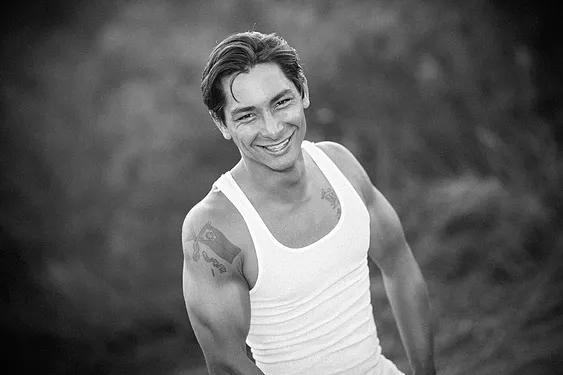 Joshua Fabia posing in white tanktop