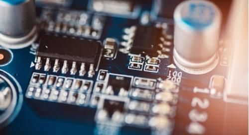 Close-up of circuit board with bypass capacitors