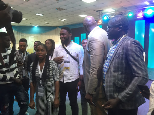 Obinna talks to a young entrepreneur at Tech Money Africa