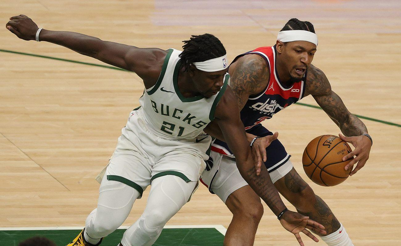 Bradley Beal #3 of the Washington Wizards is defended by Jrue Holiday #21 of the Milwaukee Bucks during the first half of a game at Fiserv Forum on May 05, 2021 in Milwaukee, Wisconsin. (Photo by Stacy Revere/Getty Images)