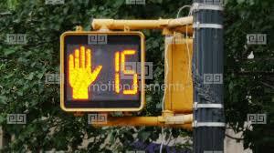pedestrian wait sign at crosswalk