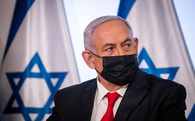 Israeli PM Benjamin Netanyahu at a joint press conference at the Ministry of Health in Jerusalem on December 9, 2020. (Yonatan Sindel/Flash90)