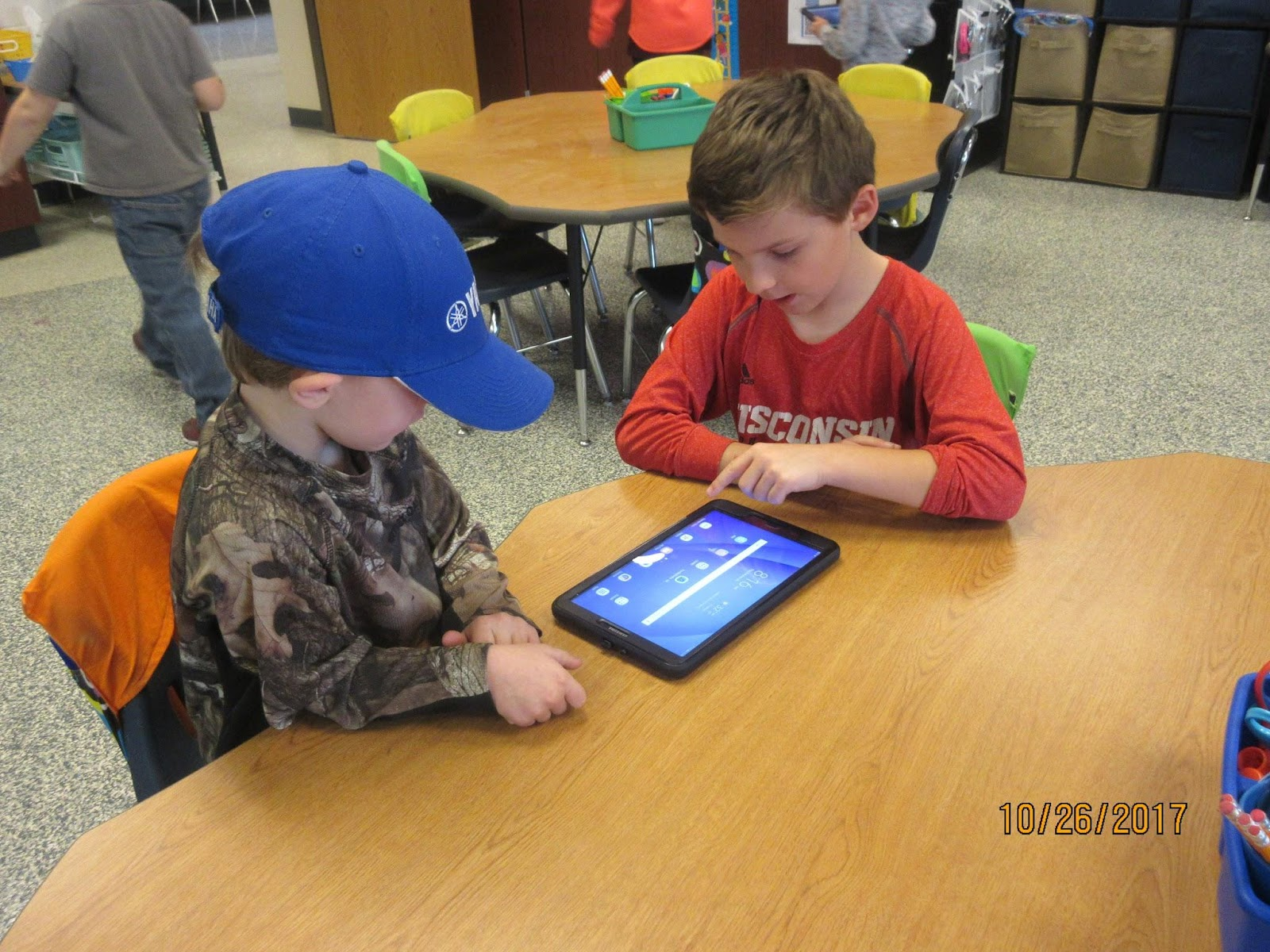 Students reading together from Seesaw