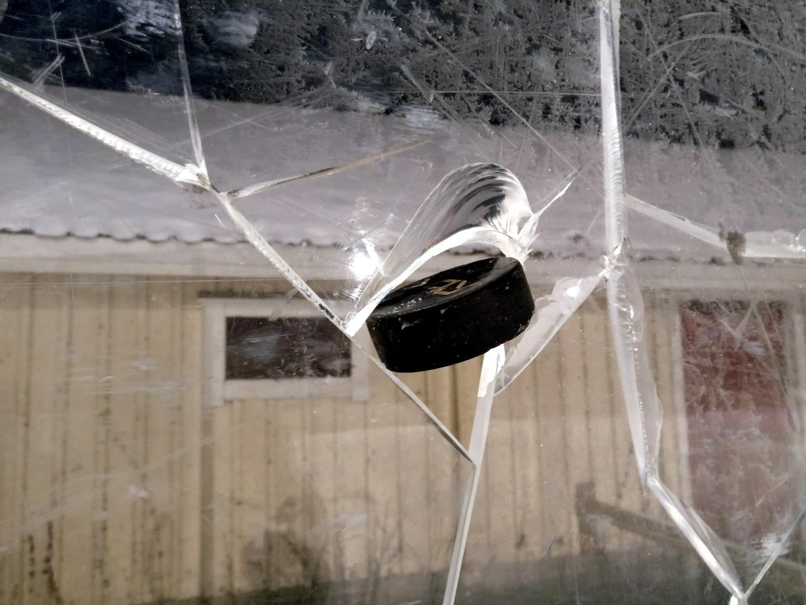 File:Ice hockey puck in broken plexiglass.jpg - Wikimedia Commons