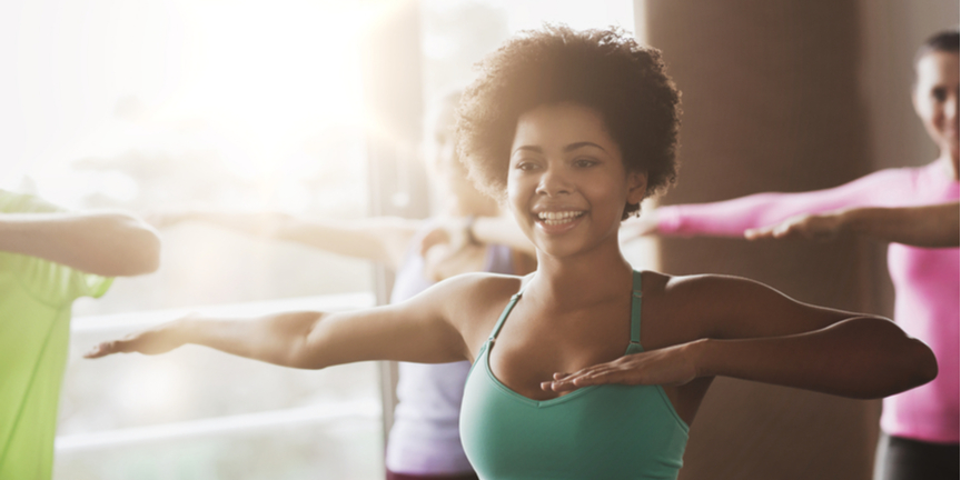 woman-doing-group-exercise-while-smiling