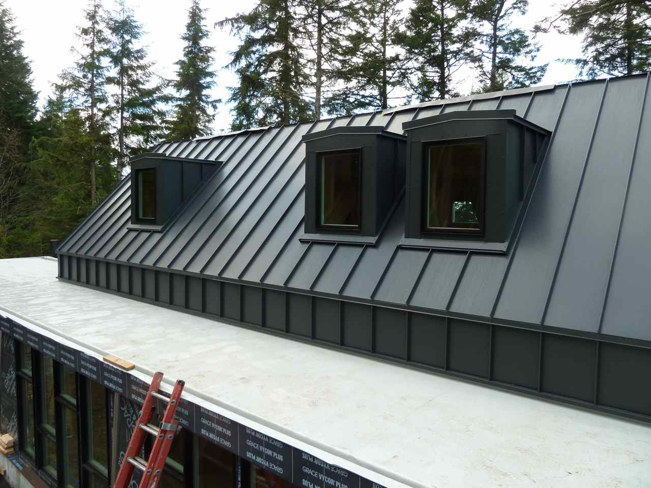 David vandervort architects lindal architects collaborative for Snow load roof pitch