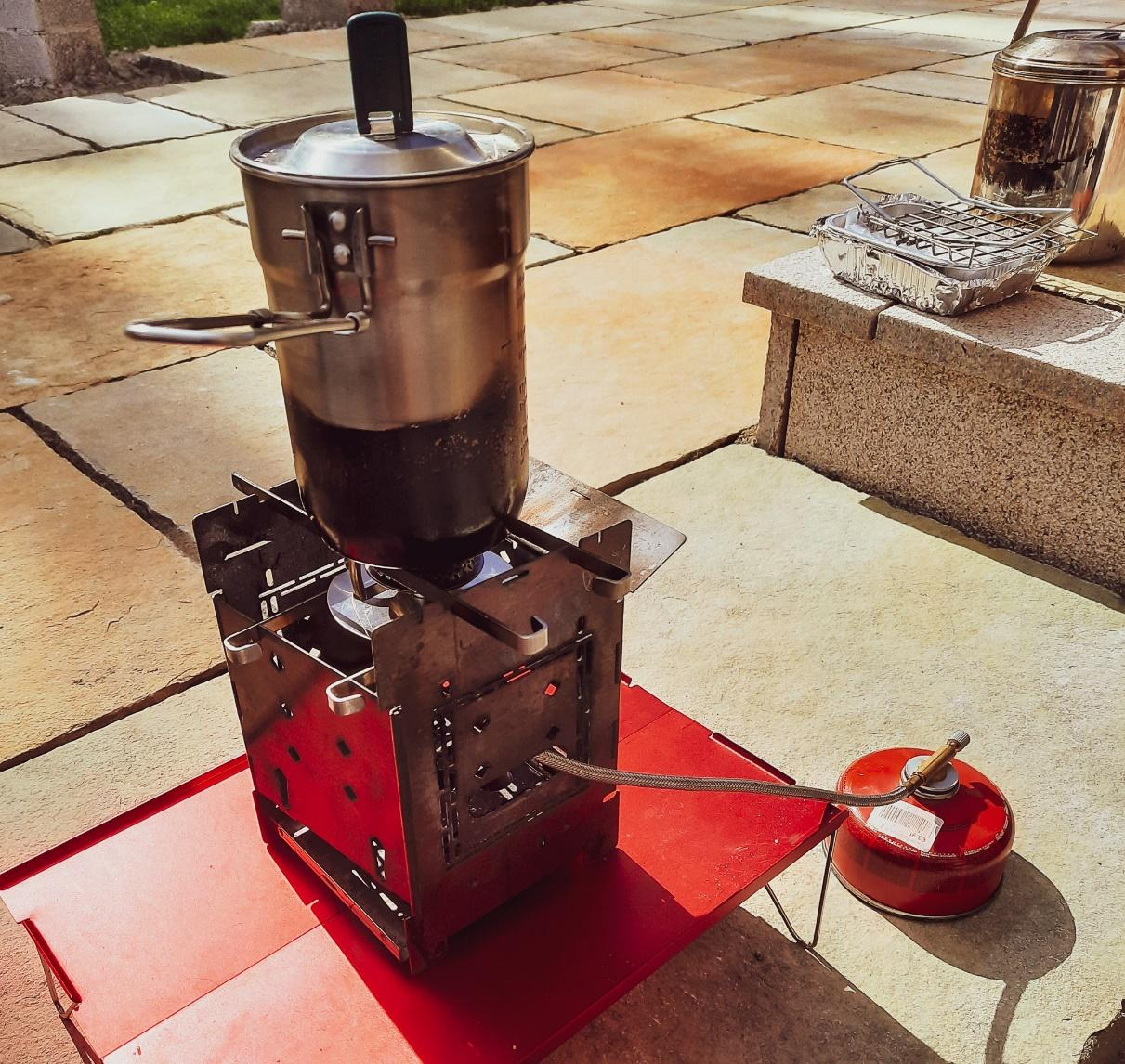 Trangia gas burner configuration supported using the firesticks