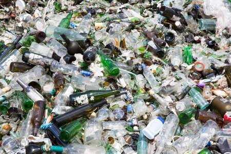 Glass waste for recycling in a recycling facility. Different glass packaging bottle waste. Glass waste management. Stock Photo - 59211521