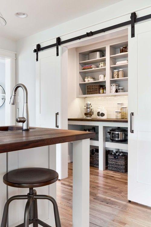 white farmhouse pantry with sliding doors, diy pantry ideas storage space with white shelving