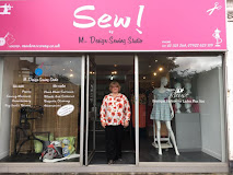 """SEW!"" Storefront with proprietor and seamstress Manuela Joynes"