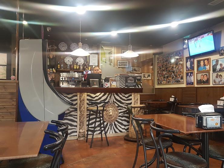 Cafetería Pizzería Afrika Carrer de Dolores Ibarruri, 35-37, 08820 El Prat de Llobregat, Barcelona