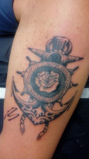 Cherry Red Tattoo & Body Piercing