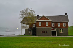 Cornell Boathouse near the water in a grey misty day