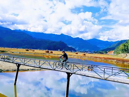 Photo of Nischal riding a bike.