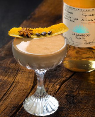 Casamigos Tequila coffee cocktail, garnished with orange peel, anise, and coffee beans