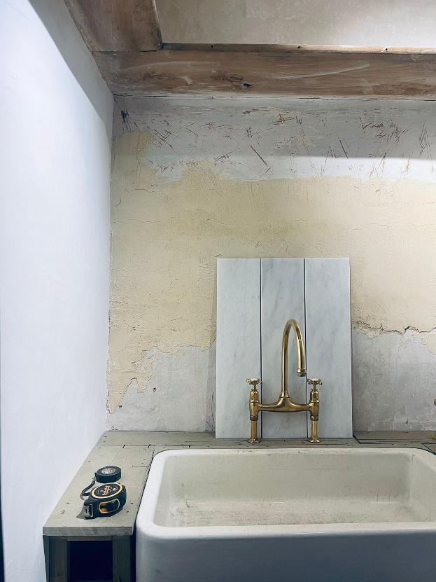 A picture containing indoor, wall, sink, toilet Description automatically generated