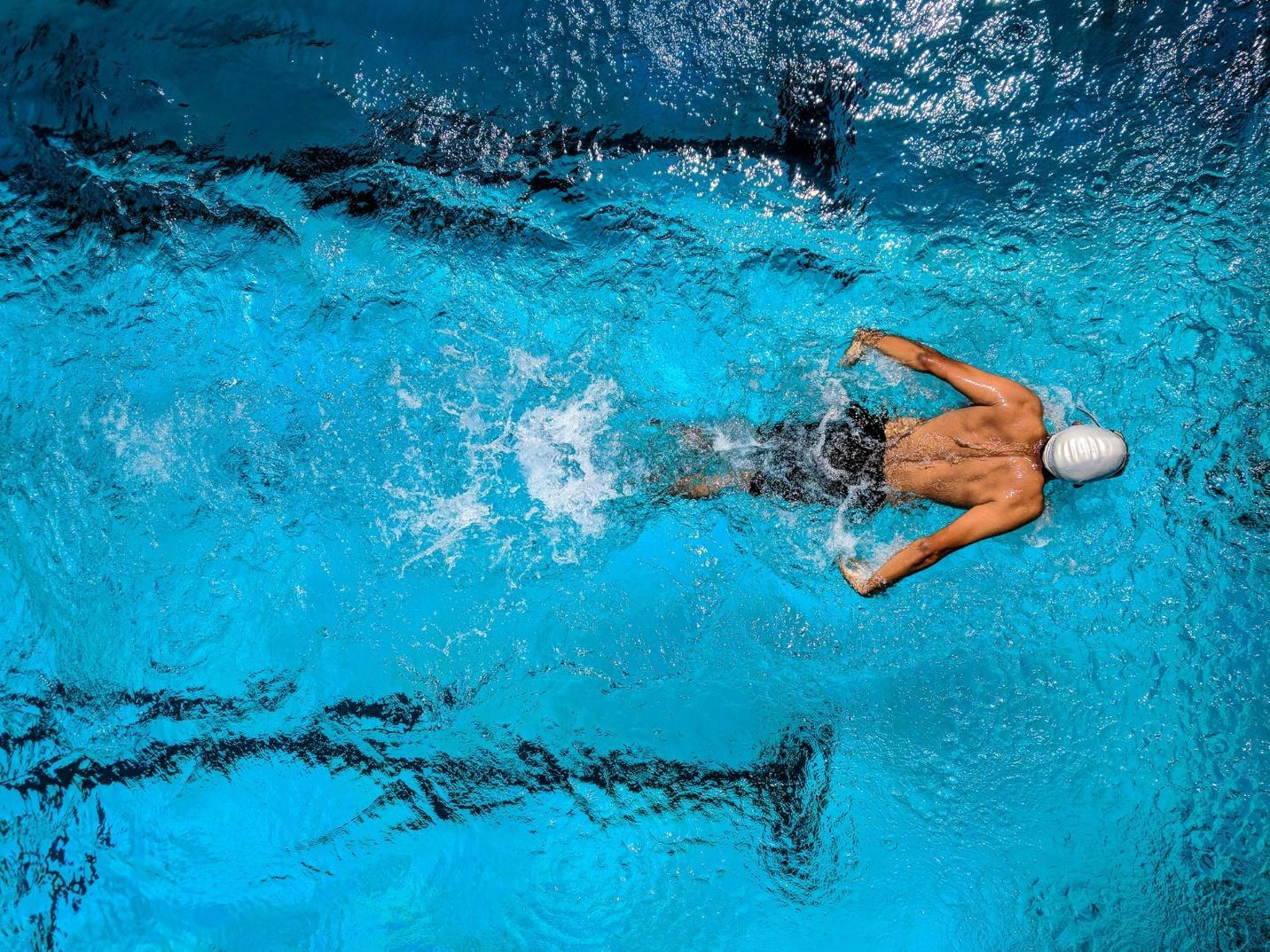 A picture containing water, sport, riding, wave  Description automatically generated