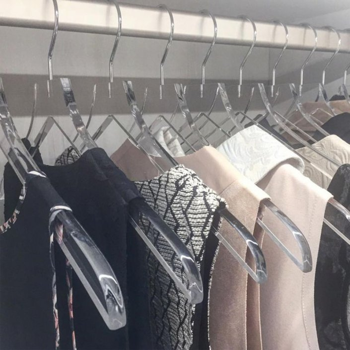 an image of hanging clothes in a row