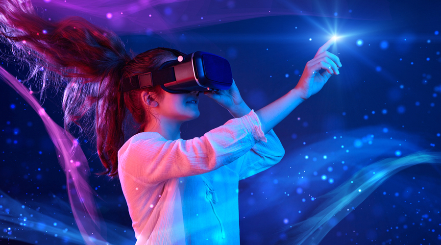 Woman wearing virtual reality headset in colourful virtual environment