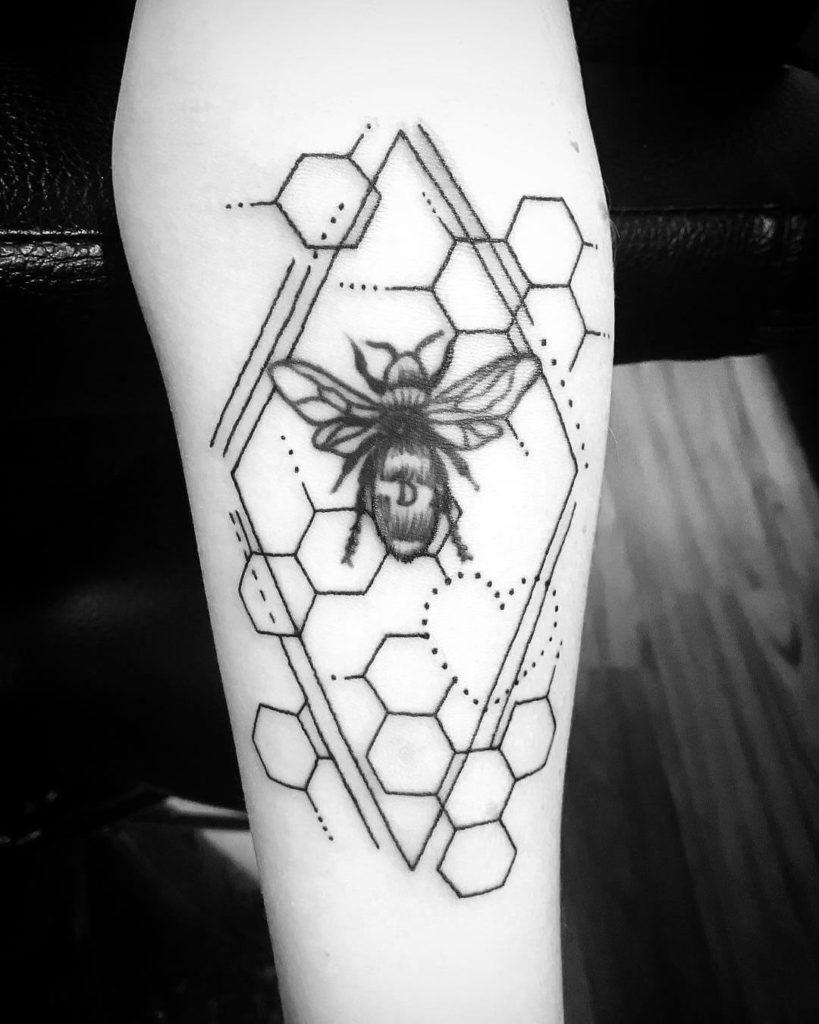 geometric bee tattoo on arm