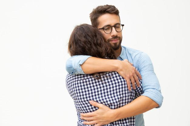 Happy young couple in love hugging Free Photo