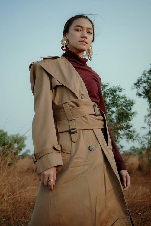 Woman In Maroon Turtleneck Top And Brown Trench Coat