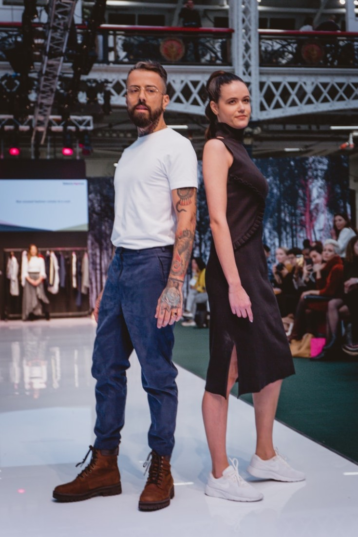 SEO Alt Text: Models Dan Pontarlier and Amanda Sarco Styled By Roberta Lee, Pure London Runway Feb 2020 | Conscious Fashion Brands | Black Dress, White Trainers