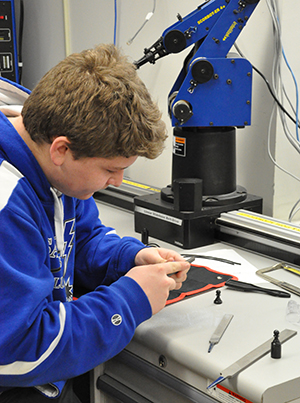 A Queensbury students works on an ECHS: Advanced Manufacturing project