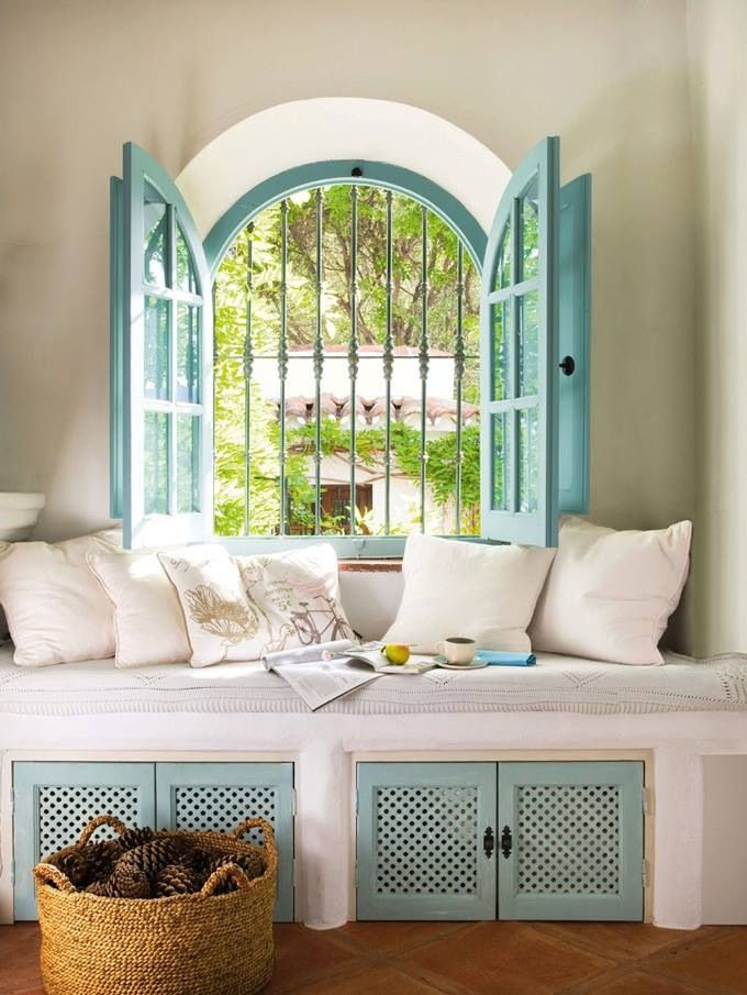 Window seat with turquoise accents