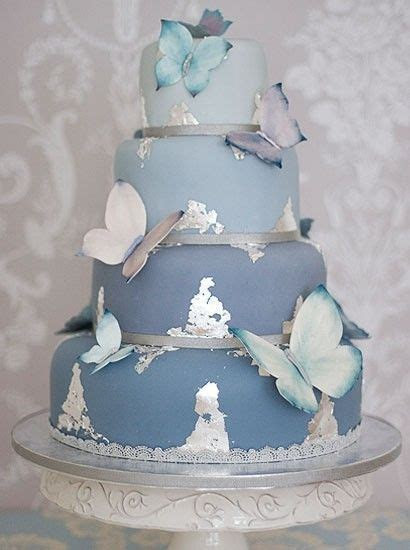 Blue butterfly wedding cake with splashes of silver   A