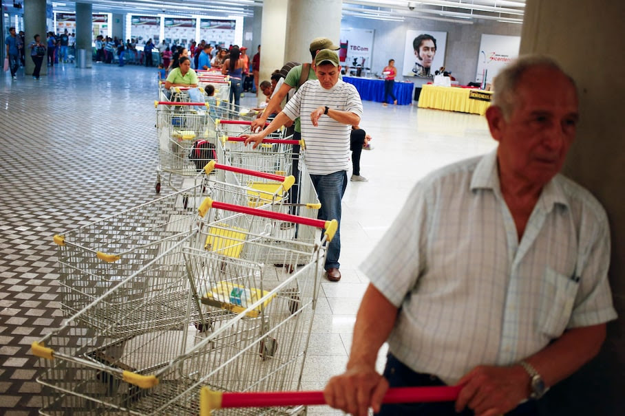 "Customers line up to get in for shopping at a state-run Bicentenario supermarket in Caracas May 2, 2014. President Nicolas Maduro is introducing a controversial shopping card intended to combat Venezuela's food shortages but decried by critics as a Cuban-style policy illustrating the failure of his socialist policies. Maduro, the 51-year-old successor to Hugo Chavez, trumpets the new ""Secure Food Supply"" card, which will set limits on purchases, as a way to stop unscrupulous shoppers stocking up on subsidized groceries and reselling them. REUTERS/Jorge Silva (VENEZUELA - Tags: POLITICS BUSINESS SOCIETY TPX IMAGES OF THE DAY)"