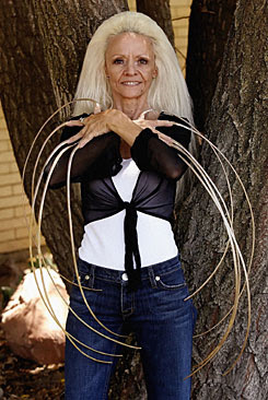 Lee Redmond shows off her fingernails, which are about 30 inches long, in Salt Lake City,  in Aug. 2006.  Redmonds fingernails were broken off in a traffic accident Tuesday. Her injuries were serious but not life threatening, according to Salt Lake County Sheriff's Office.
