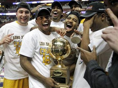 Players of CSULB's men's basketball team celebrate after defeating UC Santa Barbara, 77-64, in the Big West Conference title game on March 10, 2012.