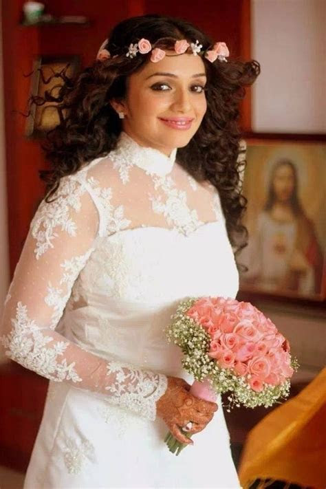 Why do Kerala Christian brides wear gowns for their