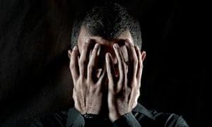 Depressed man head in hands
