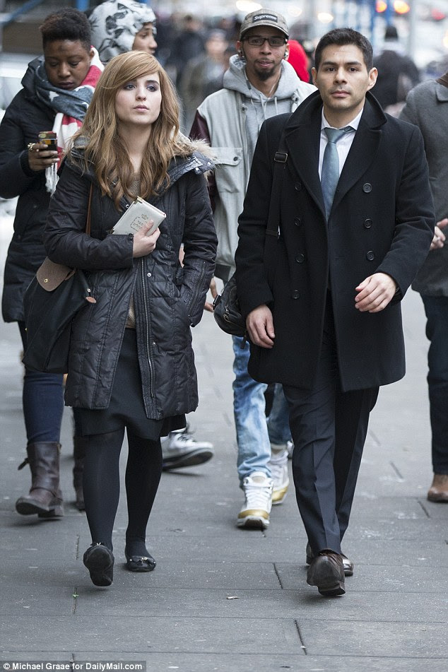 Rivky Stein, left, leaves Brooklyn Supreme Court with her lawyer, Joel Banuelos, right, on Wednesday. She testified about the rape and physical abuse she had suffered over four years of marriage