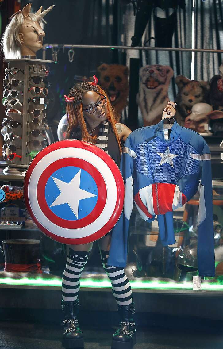 Sales associate Yoyo King shows a Captain America costume at Costumes on Haight in San Francisco, Calif., on Friday, October 16, 2015.  Marvel heroes have been recent favorites.