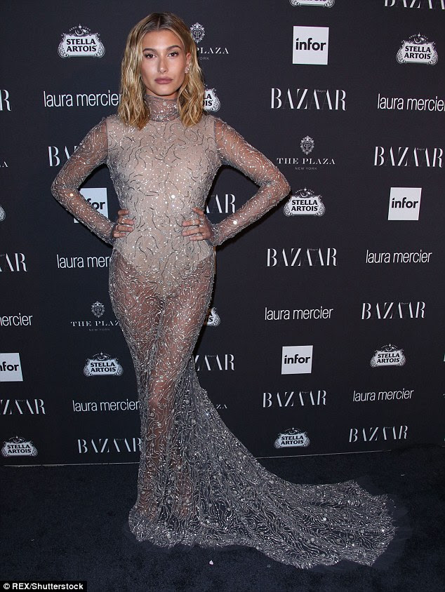 Hot metal: Hailey Baldwin stepped out in a stunning gown with sheer skirt and train at theHarper's Bazaar celebration of Icons party in New York City