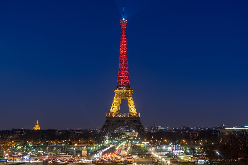 The Eiffel Tower Is Lit Up With The Belgian Flag Colors Fo