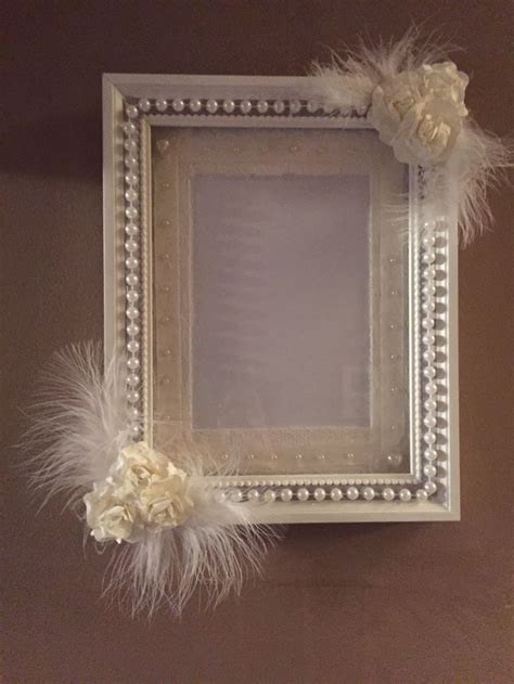 Wedding picture frame in white and Ivory. Flowers, pearls
