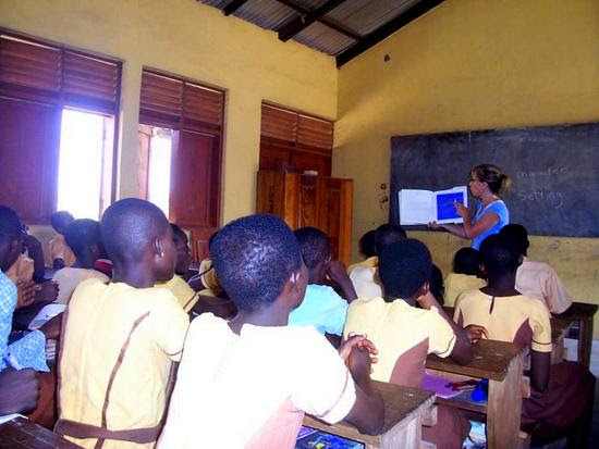 Sue volunteer teaching in Ghana, students listening attentively.
