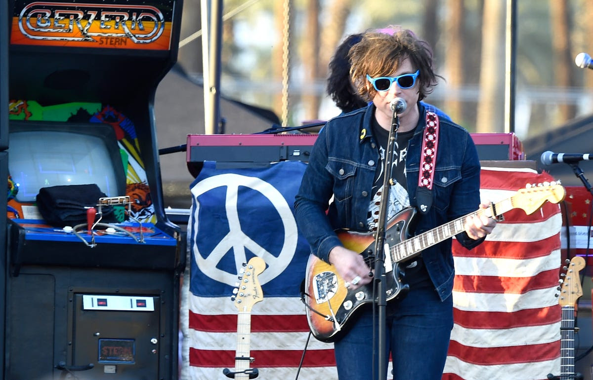 Ryan Adams performed in front of a giant arcade game.
