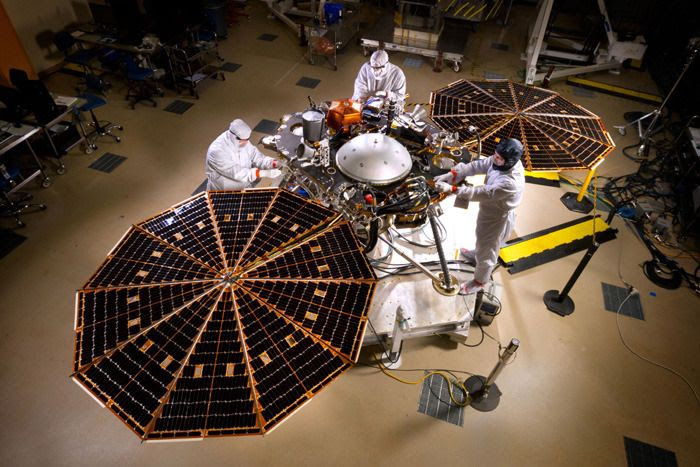 Engineers work on NASA's InSight Mars lander at the Lockheed Martin facility in Denver, Colorado...on April 30, 2015.