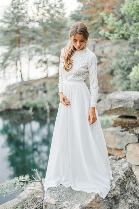 Wedding dress with high neck bodice and long lace sleeve