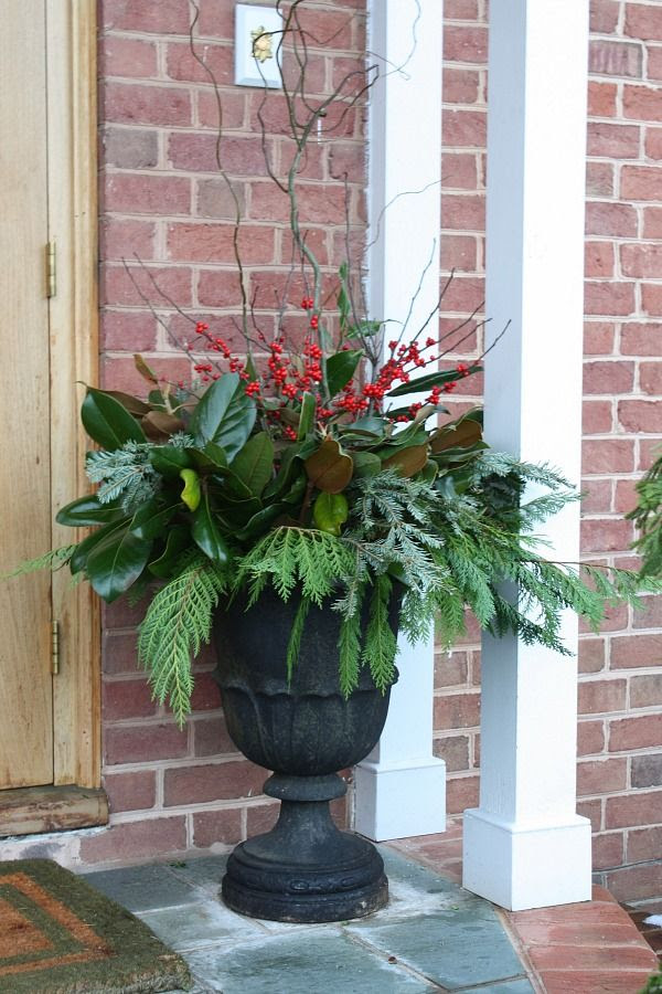 Don't forget to decorate your front porch for the holidays | Love the fresh greenery and red berries in this classic urn.