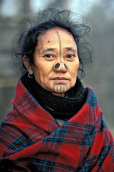The Apatani, or Tanii, are a tribal group of about 26,000 (approximately) in Ziro valley in the Lower Subansiri district of Arunachal Pradesh India.  It was customary for women to have holes in the sides of the nose, which they closed with plugs. The nose plugs and tattoos were once intended to protect daughters and women. In the past, the tribe's enemies, the Nisi, often abducted young Apatani girls. By mutilating their daughters, Apatani mothers hoped that the Nisi would lose interest.