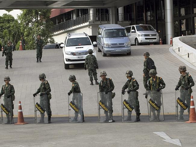 On guard ... Thai soldiers block a motorcade at the Army Club shortly after the army stag