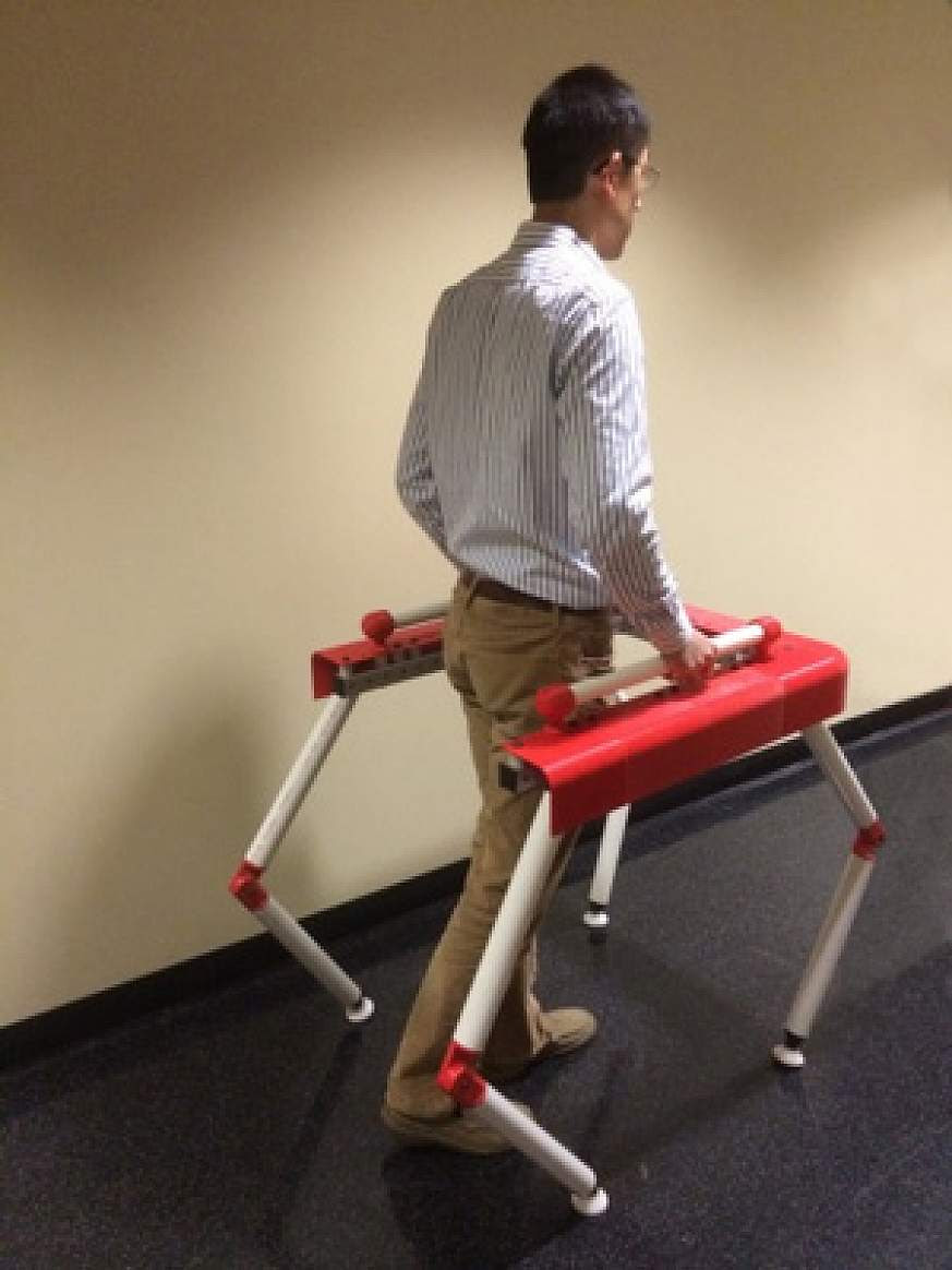Image of a person using a robotic walker