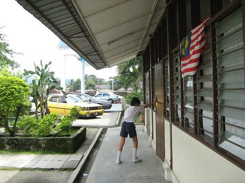 A boy leaving his class